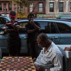 Men playing chess in street